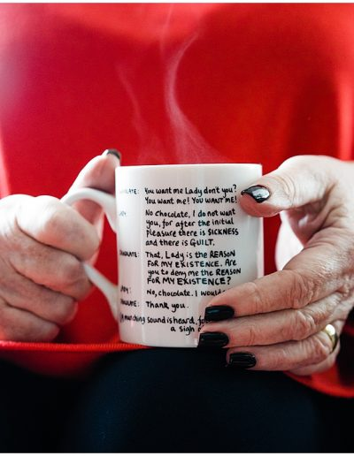 close up photo of the mug that maggie doyle is holding with a caption written on the side - Ro Photographs