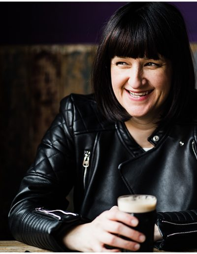 photo of Jodie from Shebeats with a small pint of Guinness smiling - Ro Photographs