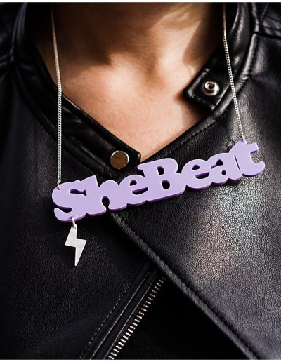 photo of Jodie from Shebeats close up of her SheBeats necklace - Ro Photographs